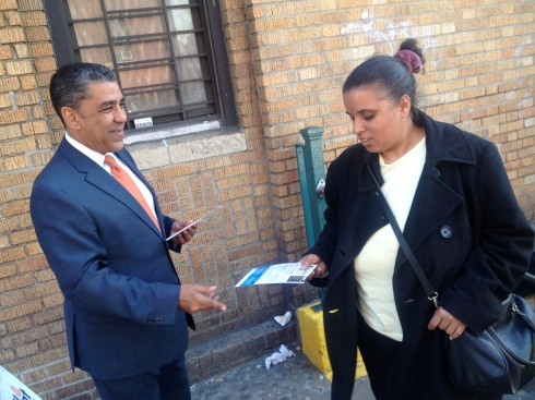 Adriano Espaillat campaigned outside the D-train station on East 196th Street and the Grand Concourse last month. Longtime congressman Charlie Rangel didn't accompany him at the BronxTalk debate today.