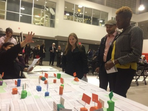 Mott Haven residents view proposed neighborhood upgrades at a meeting on Nov. 5. Photo by Maura Ewing/Mott Haven Herald